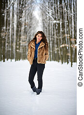 Full length of a woman outdoor in the snow - Full length of...