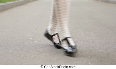 Dancer's legs close-up loop. Girl dancing solo jazz swing...