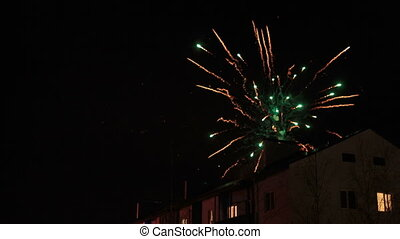 fireworks in the night sky over houses - New Year's...