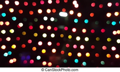 Defocused flowing light dots on colorful background -...