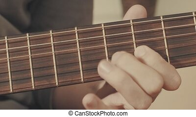 Hands of guitarist playing a guitar. Close-up
