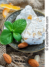 Fragrant nougat with almonds and candied orange. - Nougat...