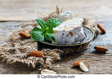 Sweet almond nougat with candied orange and mint. - Sweet...