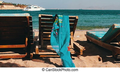 wooden chair at the beach of background of blue sea and...