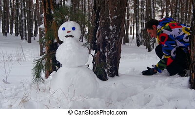 Man Making Snowman in Pine Forest, add White Snow and Finish...