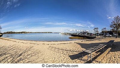 scenic view to beach and harbor of Sag Harbor in afternoon...