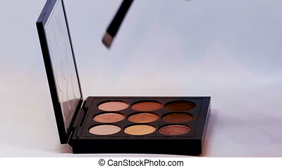 Eye Shadow Palettes - Makeup Brush Moving Over Multicolor...
