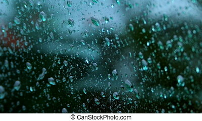 Close up of water drops running on glass