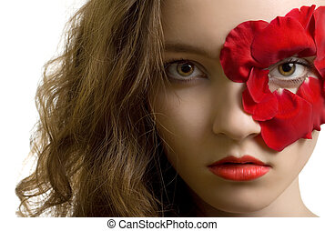 Sensual portrait of young woman in rose petals