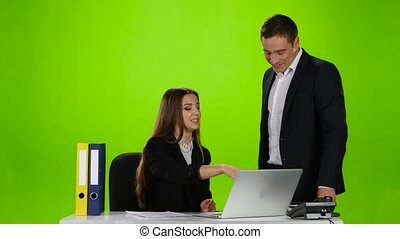 Two office workers laughing at what he saw on laptop - Girl...