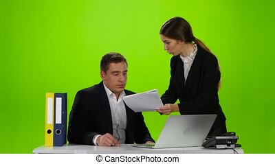 Woman boss chastises her employee man for badly made report...