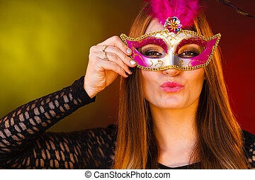 Beautiful girl in carnival mysterious mask.