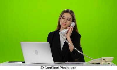 Woman answers the phone call from the office. Green Screen