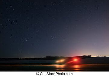 car on the highway starry night - car is moving on the...