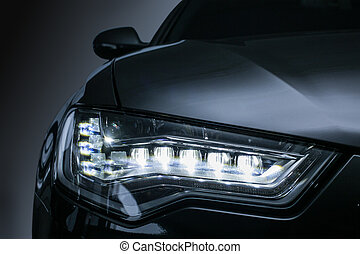 headlight of prestigious car close up - headlight of modern...