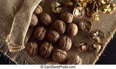 Walnuts in rotation. - Walnuts in rotation on sackcloth...