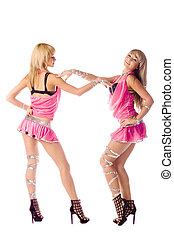 two beautiful go-go girl in pink costumes isolated
