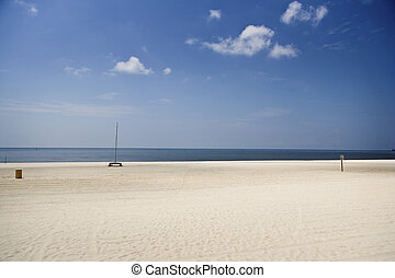 Empty Beach and Boat, Gulf Coast - An empty beach and...