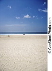 Beach and Boat, Gulf Coast - An empty beach and sailboat...