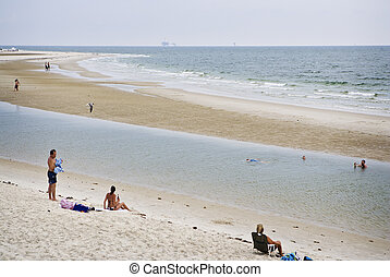 Beach Tourists, Gulf Coast - Tourists enjoy warm July waters...