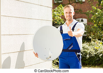 Portrait Of A Technician With TV Satellite Dish