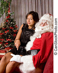 Naughty Santa - Naughty santa claus with his hand on the...
