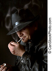 Watchman - Mafia watchman lighting a cigarette in the dark