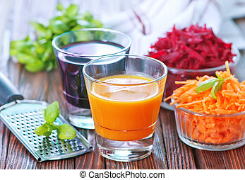 juice in glases - carrot juice and beet juice in the glasses