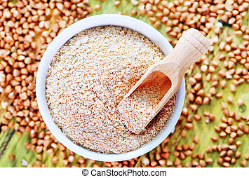 buckwheat for baby in bowl and on a table