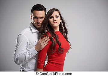 Dark hair couple on gray background