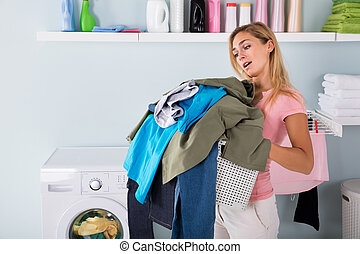 Woman Holding A Bucket Of Clothes - Young Tired Unhappy...