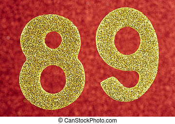 Number eighty-nine yellow color over a red background....