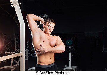 Closeup portrait of professional bodybuilder Strong muscular...