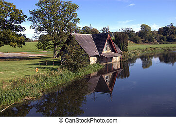 boat house on a river - picturesque boat house on a river