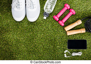Exercise Equipment Arranged On Grassy Field - High Angle...