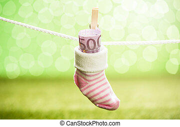 Baby Sock With Dollar Hanging On Rope