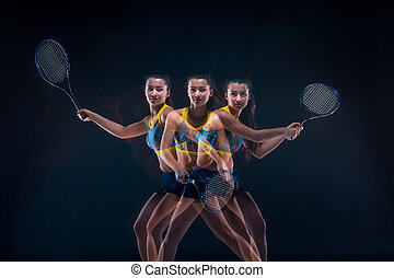 Portrait of beautiful girl tennis player with a racket on...