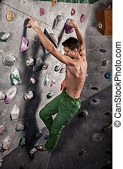 man exercise bouldering and climbing indoor - Muscular and...