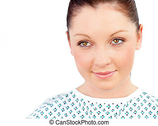 Portrait of a serious female patient smiling at the camera