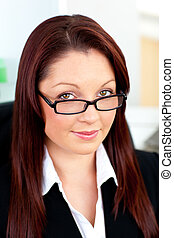 proud young business woman with glasses portrait sitting in...