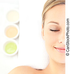 Portrait of a charming young woman lying on a massage table