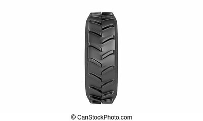 Tractor tire, spins on white background