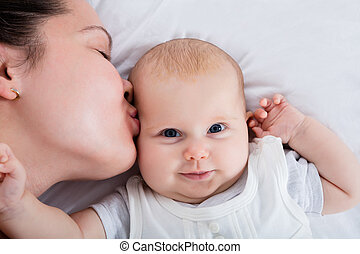 Mother Kissing Her Baby - Close-up Of A Mother Kissing Her...