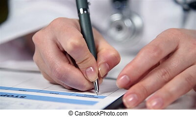 Doctor Filling Medical History - Woman Therapist Filling...