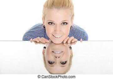 Woman mirror reflection smile on white background