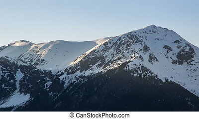 Sunset Evening over Snowy Mountain Peaks in Winter Alps Time...
