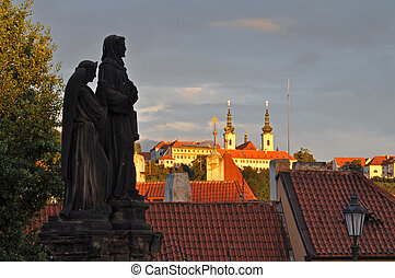 Statue at Charles Bridge during the Sunrise. - Statue at...