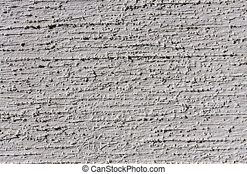 grey wall with decorative plaster as a background.