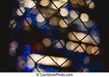 Blurry lights behind a fence in the city of Philadelphia
