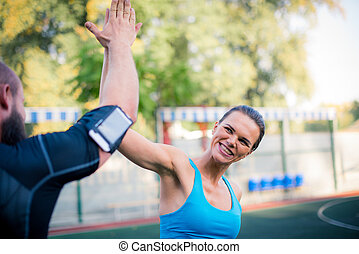 Happy couple giving high five - Happy couple workout...